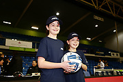 ANZ Future Captains Emma WIlson aged 10 and Isla Clayton aged 9 pose for a photo prior to the match. 2018 ANZ Premiership netball match, Mystics v Magic at The Trusts Arena, Auckland, New Zealand. 25 July 2018 © Copyright Photo: Anthony Au-Yeung / www.photosport.nz