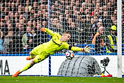 West Ham  (25) Joe Hart, dives to make a save from a shot during the Premier League match between Chelsea and West Ham United at Stamford Bridge, London, England on 8 April 2018. Picture by Sebastian Frej.