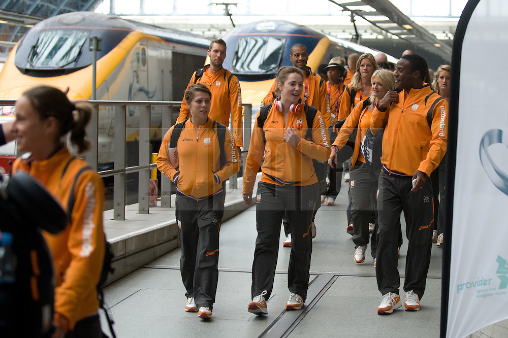 © Licensed to London News Pictures. 13/08/2012. London,UK. Dutch Olympic Team on the platform  at St. Pancras International as they leave the UK to head home following the 2012 Olympic games. Photo credit : Thomas Campean/LNP