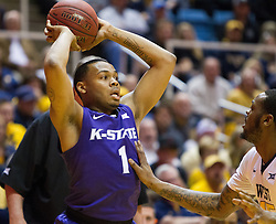 Feb 11, 2017; Morgantown, WV, USA; Kansas State Wildcats guard Carlbe Ervin II (1) looks to pass the ball during the first half against the West Virginia Mountaineers at WVU Coliseum. Mandatory Credit: Ben Queen-USA TODAY Sports
