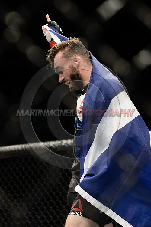 GLASGOW, SCOTLAND, JULY 18, 2015: Robert Whiteford celebrates his TKO win during UFC Fight Night 72 inside the SSE Hydro Arena in Glasgow. (Martin McNeil for ESPN)