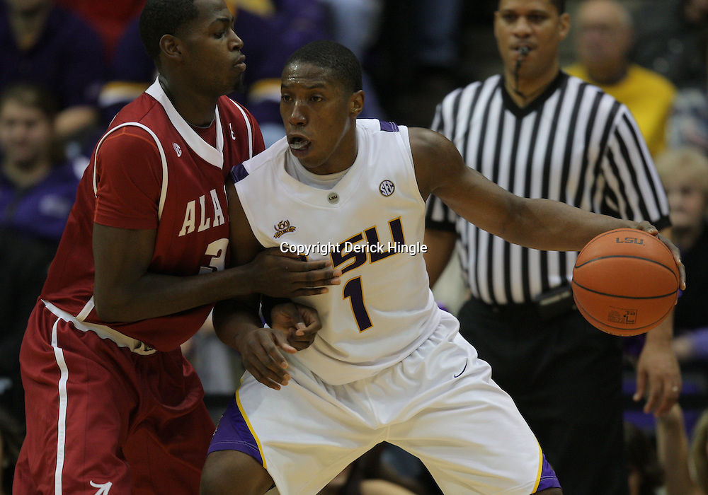 Jan 09, 2010; Baton Rouge, LA, USA; LSU Tigers forward Tasmin Mitchell (1) is guarded by Alabama Crimson Tide forward JaMychal Green (32) during the second half at the Pete Maravich Assembly Center. Alabama defeated LSU 66-49.  Mandatory Credit: Derick E. Hingle-US PRESSWIRE