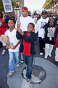 19 JANUARY 2009 -- PHOENIX, AZ: Boys carry torches through Phoenix, AZ, to honor slain civil rights leader Dr. Martin Luther King Jr. About 500 people marched three miles through Phoenix, Monday Jan. 19, in memory of Dr. Martin Luther King Jr. This year the march also marked Jan 20 inauguration of Barack Obama as the US President.    PHOTO BY JACK KURTZ