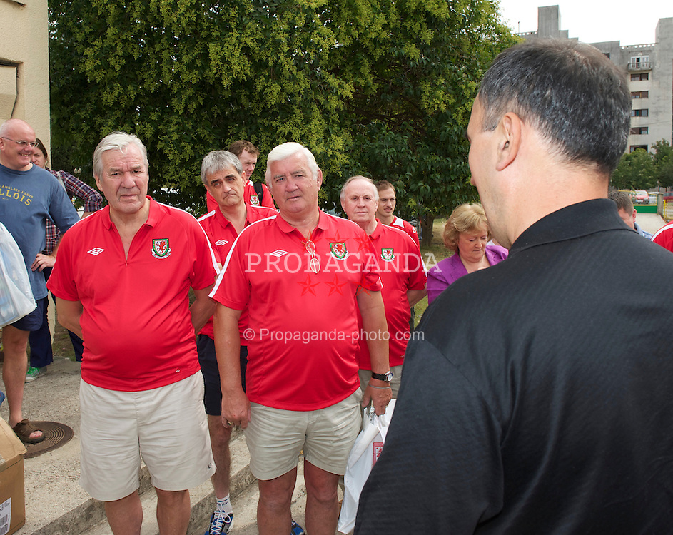 PODGORICA, MONTENEGRO - Friday, September 3, 2010: Football Association of Wales President Phil Pritchard (R) and Council Member Ron Bridges visit an orphanage in Podgorica ahead of the UEFA Euro 2012 Qualifying Group 4 match against Montenegro. (Pic by David Rawcliffe/Propaganda)