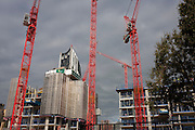 Cranes rise over the regeneration project at Elephant Park, at Elephant & Castle, London borough of Southwark. Southwark Council's development partner, Lendlease is regenerating over 28 acres across three sites at the heart of Elephant & Castle, in what is the latest major regeneration opportunity in zone 1 London. The vision for the £1.5 billion regeneration is to build on the area's strengths and vibrant character in order to re-establish Elephant & Castle as one of London's most flourishing urban quarters. The Elephant & Castle regeneration is of a scale rarely seen in central London and includes almost 3,000 new homes, plus office, retail, community, leisure and restaurant space.