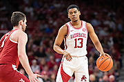 FAYETTEVILLE, AR - MARCH 9:  Mason Jones #13 of the Arkansas Razorbacks with the ball during a game against the Alabama Crimson Tide at Bud Walton Arena on March 9, 2019 in Fayetteville, Arkansas.  The Razorbacks defeated the Crimson Tide 82-70.  (Photo by Wesley Hitt/Getty Images) *** Local Caption *** Mason Jones