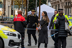 © Licensed to London News Pictures. 06/12/2019. London, UK. A Harrods doorman at the scene where a tent stands in Hans Crescent. A body of what is believed to be a man in his 20s has been found with stab wounds outside Harrods in knightsbridge, London around 1am this morning. Police teams are on the scene. Photo credit: Alex Lentati/LNP