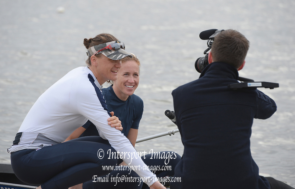 Reading, UNITED KINGDOM. Film crew filming left Heather STANNING and Helen GLOVER at the GBR Media Day, Redgrave and Pinsent Rowing Lake. GB Rowing Training Base, Caversham, Berks. Wednesday   19/03/2014 [Mandatory Credit: Peter Spurrier/Intersport Images]
