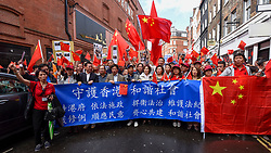 © Licensed to London News Pictures. 18/08/2019. LONDON, UK.  Members of the capital's Chinese community hold a rally of support for the people of Hong Kong and for China.  They are calling for end to police violence and a respect for law as protests in the former British colony enter their eleventh week.  Photo credit: Stephen Chung/LNP