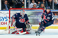 KELOWNA, BC - MARCH 7: Carl Tetachuk #35 defends the net as Chase Wheatcroft #26 of the Lethbridge Hurricanes clears the puck from the crease during first period against the Kelowna Rockets at Prospera Place on March 7, 2020 in Kelowna, Canada. (Photo by Marissa Baecker/Shoot the Breeze)
