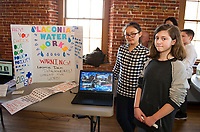 6th grade students Scarlet Fontanez and Jennifer Arsenault present their project on Laconia Water Works dam dangers during Makers Night at the Belknap Mill Thursday.   (Karen Bobotas/for the Laconia Daily Sun)