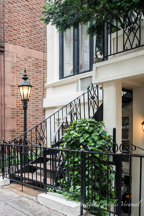 Entrance staircase and lantern to townhouse 109 Est 61st street in Manhattan