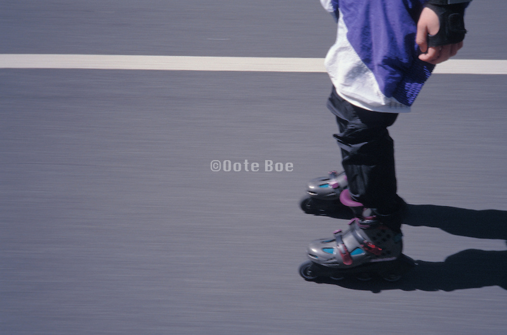 cropped view of rollerblader on street