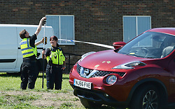 © Licensed to London News Pictures. 25/06/2017. NEWCASTLE UPON TYNE, UK. Police gather evidence near Westgate Sports Centre where a car hit worshippers leaving Eid prayers. There are believed to be at least six people hurt in the incident. A 42 year old woman was arrested at the scene. Photo credit: MARY TURNER/LNP