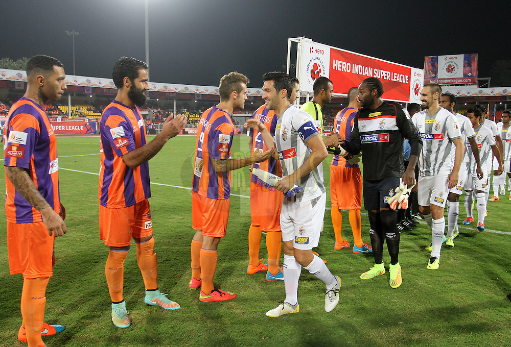 FC Pune City and Atletico de Kolkata players shake hands before the start of  match 44 of the Hero Indian Super League between FC Pune City and Atletico de Kolkata FC held at the Shree Shiv Chhatrapati Sports Complex Stadium, Pune, India on the 29th November 2014.<br /> <br /> Photo by:  Vipin Pawar/ ISL/ SPORTZPICS