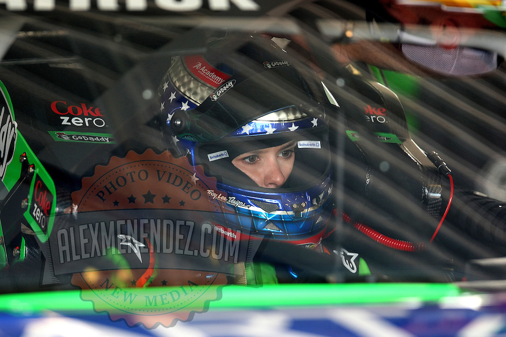 NASCAR Sprint Cup driver Danica Patrick (10) is seen in the garage area during the NASCAR Coke Zero 400 Sprint practice session at the Daytona International Speedway on Thursday, July 4, 2013 in Daytona Beach, Florida.  (AP Photo/Alex Menendez)