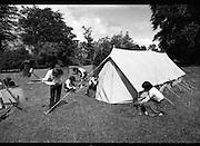 300 Girl Guides At Larch Hill.  (R84)..1988..25.07.1988..07.25.1988..25th July 1988..As part of the Diamond Jubilee celebrations the girl guide movement organised a friendship camp for 300 girls.The friendship camp was set up in the grounds of Larch Hill, Tibradden,Co Dublin. The camp will run from 23rd July to 30th July...Tent pitching is one of the many skills which the girls will learn. Pictured, these girls make sure that their accomodation for the week is well set up.