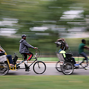 Bike riders in Central Park, Manhattan, New York, USA. Photo Tim Clayton
