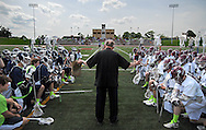 7 MAY 2009 -- CREVE COEUR, Mo. -- The Rev. Michael Marchlewski, known to generations of students at St. Louis University High School and DeSmet Jesuit High School as Father Marco, leads the lacrosse teams from the schools in prayer before their annual game Saturday, May 7, 2011. The teams met in Creve Coeur, Mo. to contest the 2011 Father Marco Cup, the final game of the season between the two Jesuit rivals. The cup is named for The Rev. Marchlewski, who has served as spiritual advisor to students at both schools. The Rev. Marchlewski spent the first half on the DeSmet sidelines and the second half on the SLUH bench. Image © copyright 2011 Sid Hastings.