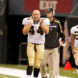 2009 August 14: New Orleans Saints FB Heath Evans (44) watches from the sideline during 17-7 win by the New Orleans Saints over the Cincinnati Bengals in their preseason opener at the Louisiana Superdome in New Orleans, Louisiana.