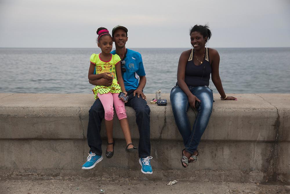 Family portrait at Malecon in Havana, Cuba.