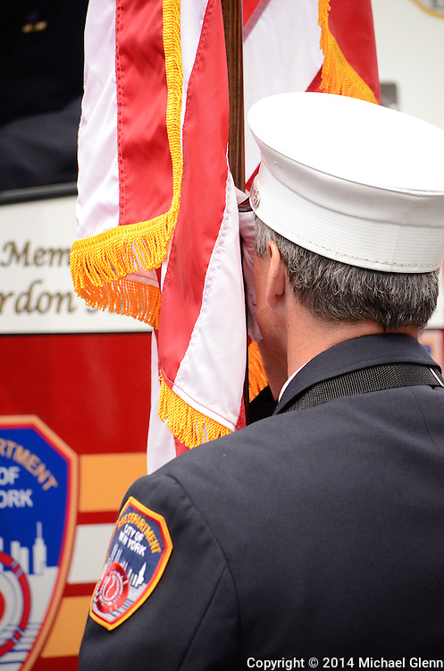 Staten Island, New York - July 10:  Firefighter of the Color Guard stands at attention at the Funeral of Lt Gordon M. Ambelas L119 at Saint Clares Church on July 10, 2014 in New York, New York. Photo Credit: Michael Glenn / Glenn Images