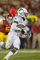 03 November 2012: Runningback (24) Kenjon Barner of the Oregon Ducks runs the ball against the USC Trojans during the second half of Oregon's  62-51victory over USC at the Los Angeles Memorial Coliseum in Los Angeles, CA.