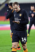 Hull City midfielder Kamil Grosicki (14) looks at his pre-match instructions on the palm of his hand prior to the EFL Sky Bet Championship match between Hull City and Swansea City at the KCOM Stadium, Kingston upon Hull, England on 22 December 2018.