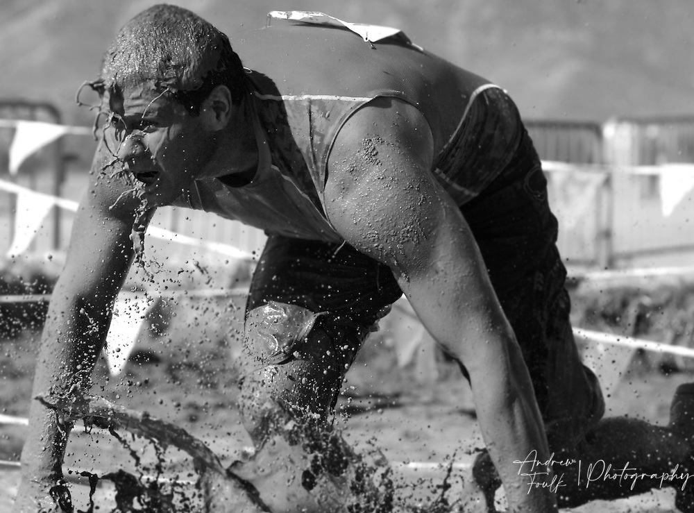/Andrew Foulk/ For The Californian/ .A competitor in the Lake Elsinore Gladiator Run, makes his way out of the mud pit during the 5K run.