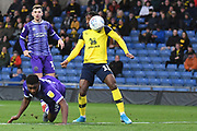 Oxford United midfielder Tarique Fosu-Henry  (11) heads the ball  during the EFL Sky Bet League 1 match between Oxford United and Shrewsbury Town at the Kassam Stadium, Oxford, England on 7 December 2019.