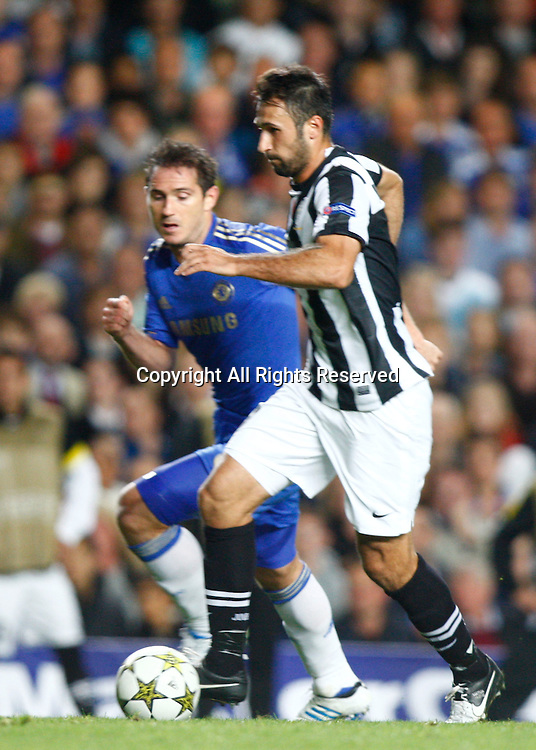 19.09.12 London, ENGLAND: <br /> Mirko Vucinic of Juventus F.C. and Frank Lampard of Chelsea<br /> during the UEFA Champions League Group E match between Chelsea and  Juventus at Stamford Bridge Stadium
