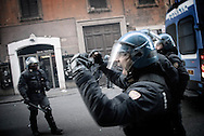 ITALY, Rome : Police march to Piazza del Popolo after vehicules were set on fire during a protest to demand a change of government as parliament met to hold a crucial vote that could topple Prime Minister Silvio Berlusconi on December 14, 2010 in Rome. Italian Prime Minister Silvio Berlusconi scraped through a crucial confidence vote in the lower house of parliament by 314 votes in favour and 311 against
