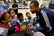 Utah Jazz player Mo Williams, right, leads a cheer during a private basketball clinic for local at-risk youth from the Dream Academy at the Zions Bank Basketball Center, Wednesday, Oct. 24, 2012.