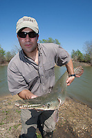 ANGLER WITH AN ALLIGATOR GAR9