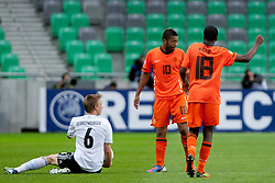 Nico Brandenburger of Germany, Tonny Trindade de Vilhena and Queensy Menig of Netherlands during the UEFA European Under-17 Championship Final match between Germany and Netherlands on May 16, 2012 in SRC Stozice, Ljubljana, Slovenia. (Photo by Urban Urbanc / Sportida.com)