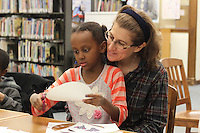 Families were invited out Wednesday evening for stories, arts and crafts by the Blackstone Library located at 4904 S. Lake Park Ave.<br /> <br /> 0664, 0665, 0666 – Jocelyn Malamy and her daughter Eve make elephants out of paper.