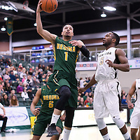 5th year guard Aaron McGowan (1) of the Regina Cougars in action during the home game on January  14 at Centre for Kinesiology, Health and Sport. Credit: /Arthur Images