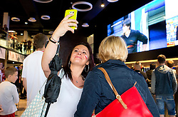 A Poland fan takes a selfie while watching her nations fixture with Germany on the big screen in the Sports Bar and Grill at Ashton Gate - Mandatory by-line: Robbie Stephenson/JMP - 16/06/2016 - FOOTBALL - Ashton Gate - Bristol, United Kingdom  - Germany vs Poland - UEFA Euro 2016