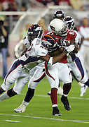 GLENDALE, AZ - AUGUST 31:  Safety Sam Brandon #42 of the Denver Broncos lays a wicked hit on wide receiver Anquan Boldin #81 of the Arizona Cardinals after a pass reception at Cardinals Stadium on August 31, 2006 in Glendale, Arizona. The Broncos defeated the Cards 29-23. ©Paul Anthony Spinelli *** Local Caption *** Sam Brandon;Anquan Boldin