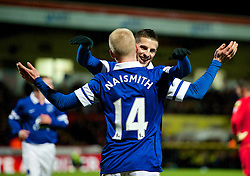 STEVENAGE, ENGLAND - Saturday, January 25, 2014: Everton's Steven Naismith celebrates scoring the second goal against Stevenage with team-mate Kevin Mirallas during the FA Cup 4th Round match at Broadhall Way. (Pic by Tom Hevezi/Propaganda)