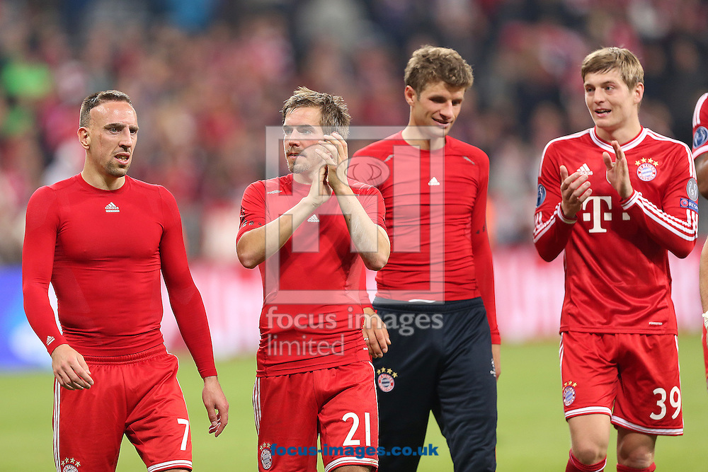 From left to right, Franck Ribery, Philipp Lahm, Thomas Muller and Toni Kroos of Bayern Munich celebrate after beating Manchester United 3-1 in the UEFA Champions League match at Allianz Arena, Munich<br /> Picture by Richard Calver/Focus Images Ltd +447792 981244<br /> 09/04/2014