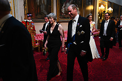 Prime Minister Theresa May and the Duke of Cambridge, followed by the Duchess of Cambridge and United States Secretary of the Treasury, Steven Mnuchin, as they arrive through the East Gallery during the State Banquet at Buckingham Palace, London, on day one of the US President's three day state visit to the UK.