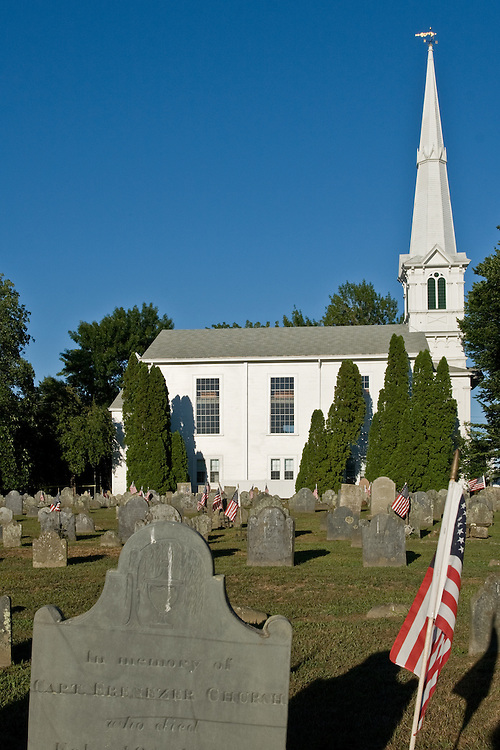The  United Congregational Church in Little Compton, Rhode Island, seen from its graveyard. The building dates to 1835.