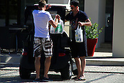 EXCLUSIVE<br /> <br /> England football star Steven Gerrard in Portugal takes to modes of transport around portugal stunning blue merceds then off to the shops in a golf buggy to stock up on same shopping!<br /> ©Exclusivepix