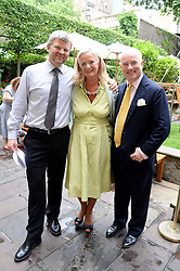 Left to right, ADRIAN CHILES, CLARISSA BALDWIN Chief Executive Officer of Dogs Trust and PHILIP DAUBENY Dogs Trust Chairman at the 6th Dogs Trust Honours held at Home House, Portman Square, London on 23rd July 2013.
