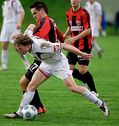 Mark Bozic of Primorje vs Uros Smolej of Triglav at football match between NK Primorje Ajdovscina and NK Triglav Gorenjska of Second Slovenian football league, on May 16, 2010 in Vipava, Slovenia. Primorje placed first in 2.SNL and qualified for  PrvaLiga in season 2010/2011. (Photo by Urban Urbanc / Sportida)