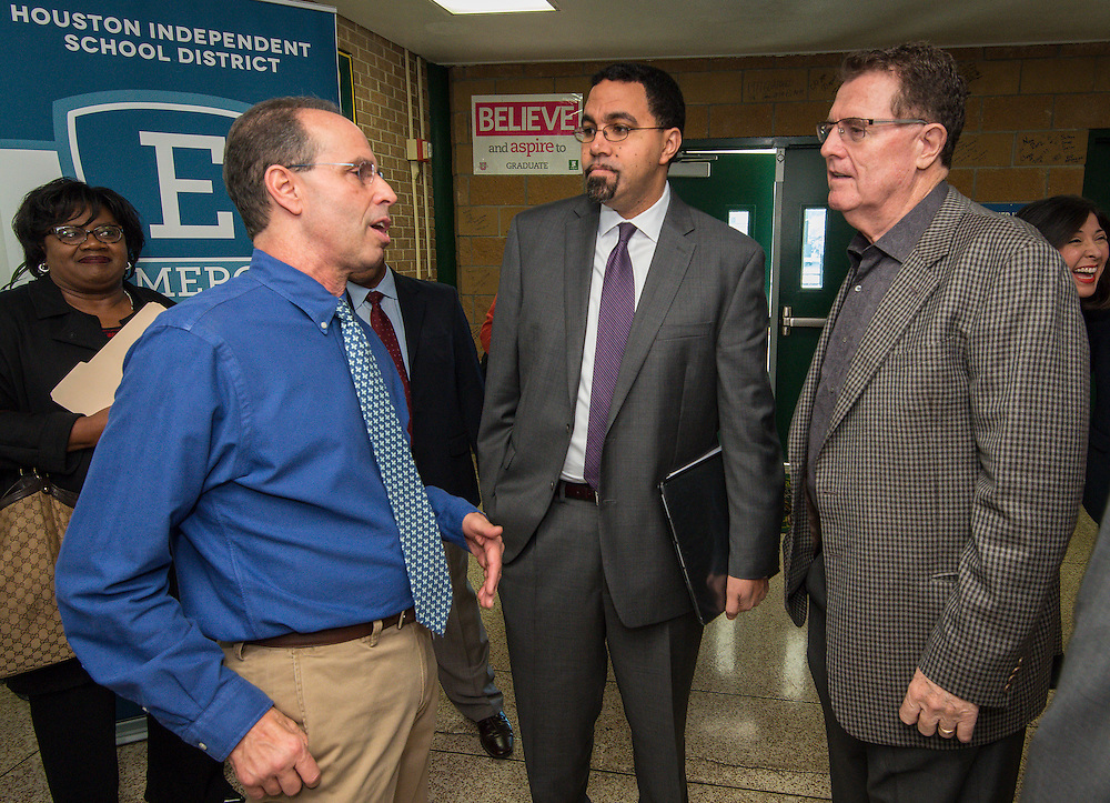 Acting US Secretary of Education John King, center, is greeted by Robert Gasparello, left, and Houston ISD Superintendent Dr. Terry Grier, right, for a tour of Sharpstown High School, January 15, 2016.