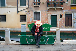A gondolier checks his phone in Venice. From a series of travel photos in Italy. Photo date: Sunday, February 10, 2019. Photo credit should read: Richard Gray/EMPICS