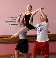 Tyler Long (far left), and Zach York, both from Bellbrook lift __ at a rehearsal for the year-end recital at Terre's Dance Workshop in Kettering, Tuesday, May 8th.