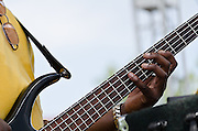 William Harris, the bass player with Zac Harmon, lossening up the fingers prior to performing at the Riverfront Blues Festival in Wilmington,DE.